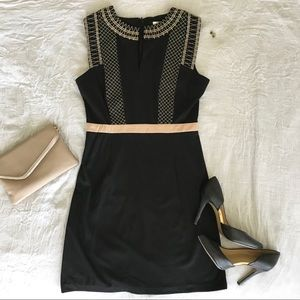 Black dress with tan embroidery